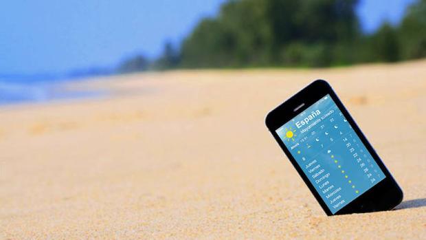 El teléfono móvil también se usa en la playa